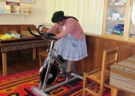 Young woman on an exercise bicycle
